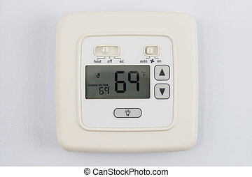 digital thermostat on light blue wall set to heating 69...