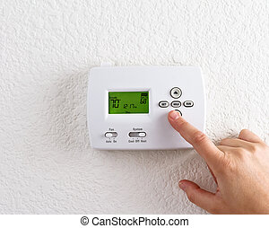 digital thermostat with finger