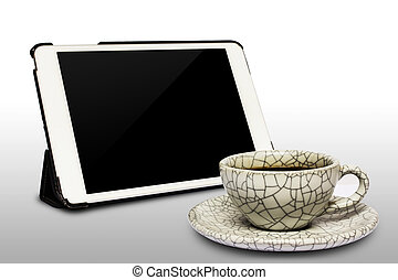 digital white tablet and coffee cup isolated on white background,clipping path.