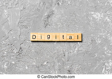 DIGITAL word written on wood block. DIGITAL text on cement table for your desing, concept
