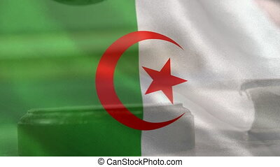 Digitally composite of Algerian Flag and gavel. Judges gavel banging on sounding block 4k