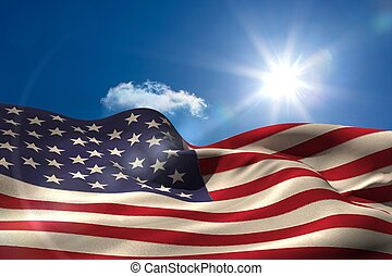 Digitally generated american flag rippling against blue sky