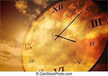 Digitally generated roman numeral clock on orange sky