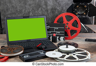 digitizing the old 16 mm film with laptop and green screen