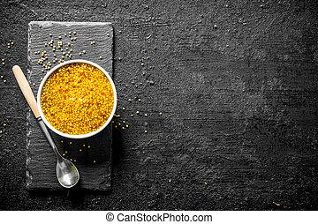 Dijon mustard in the bowl.