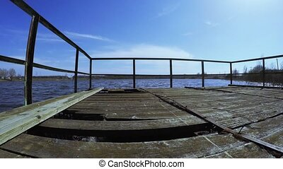 Dilapidated bridge on the lake - On the shore of the lake a...