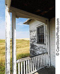 Dilapidated building. - View from porch of weathered...