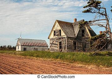 Dilapidated dwelling behind a farmer's field in Prince Edward Island