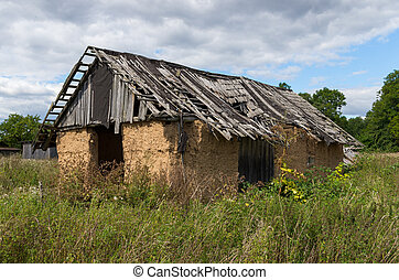 Dilapidated old farm shack in a field