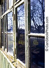 Dilapidated windows - Dilapidated rotten windows on derelict...