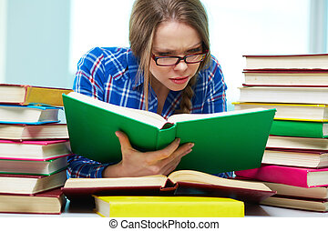 Diligence - Diligent student being absorbed in studying