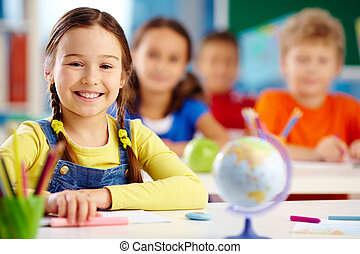 Portrait of an elementary school student with a toothy smile
