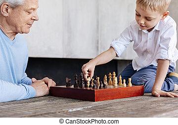 Diligent enterprising boy making a strategic move
