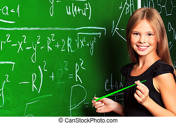 diligent - Portrait of a smiling schoolgirl in a classroom.