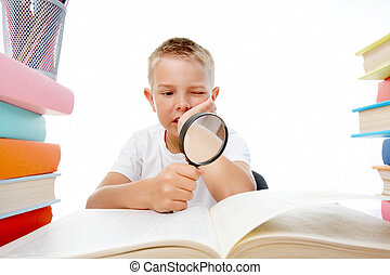 Diligent pupil - Smart youth reading open book before him...