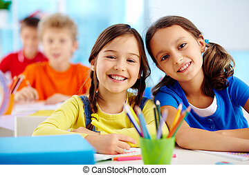 Diligent pupils - Portrait of two diligent girls looking at ...