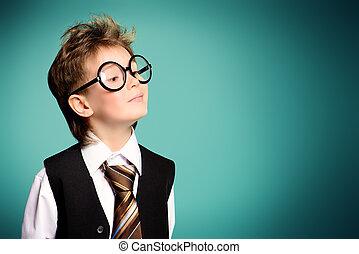diligent - Portrait of a cute smart boy wearing suit and...