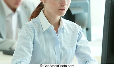 Diligent worker - Tilt up of an office girl concentrated on...