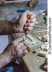Man carves intricate wooden alphabet blocks