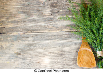 Dill on wooden table with copy space