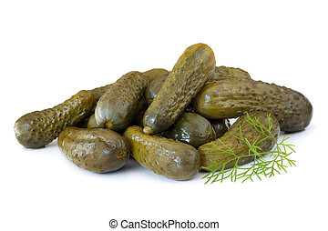 Dill Pickles - Heap of dill pickles with a sprig of fresh...