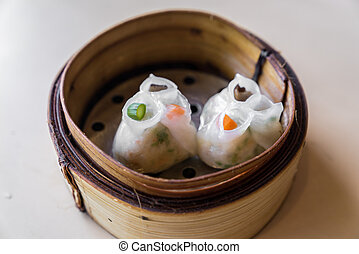 Dim sum - Chinese dim sum in wooden basket