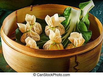 Dim sum dumplings in bamboo basket