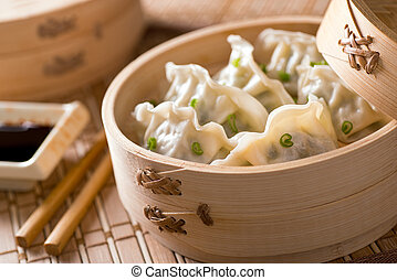 Dim Sum - Dim sum with leeks, meat, and green onions in a...
