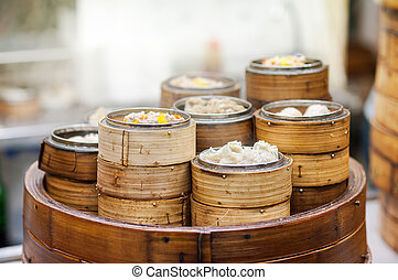 Dim sum steamers at a Chinese restaurant, Hong Kong - Dim...