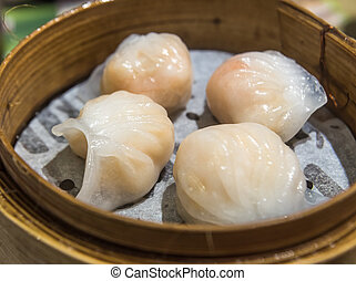 Dim Sum, traditional Cantonese dumplings, cooked in bamboo...