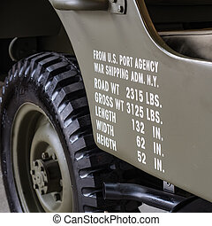 Dimensions and weights printed on the side of a military off road.
