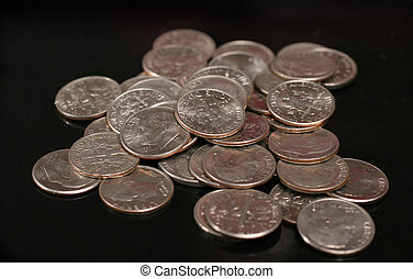 dimes and euro coins ower black