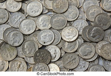 Dimes - Colored photograph of a pile of dimes. Picture taken...