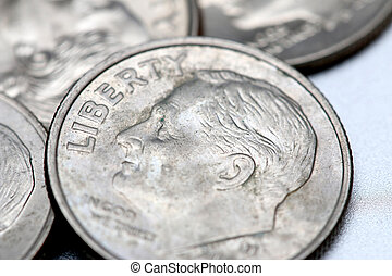 Dimes isolated on a silver background