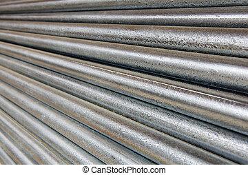 Diminishing Galvanized Pipe - Pile of shiny galvanized steel...