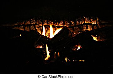 Dimly lit fireplace - This fireplace has dimly flickering...