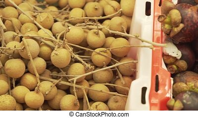 Dimocarpus longan and Purple mangosteen sold in supermarket stock footage video