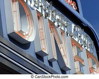 Diner Sign - Sectional shot of neon diner sign detail.