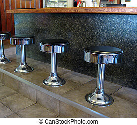Diner Stools - A row of stools at the diner.