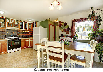 Dining and kitchen room interior in family house