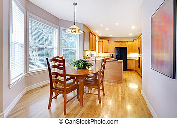 Dining area dn kitchen with maple oak wood and grey walls
