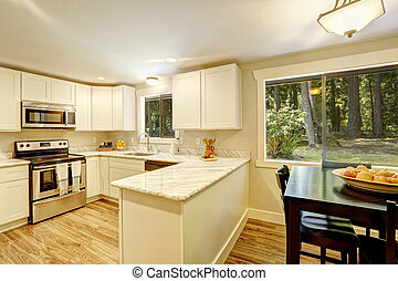Dining area in bright kitchen room