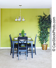 Dining area - Small dining area with black dining set and a...