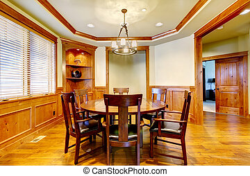 Dining luxury room with wood molding and floor. - Dining...