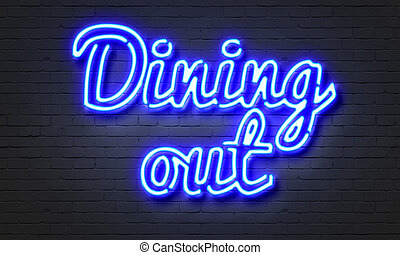 Dining out neon sign on brick wall background. - Dining out...