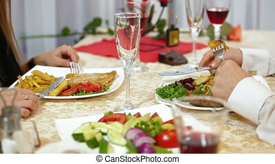 dining out - couple having a dinner in a restaurant