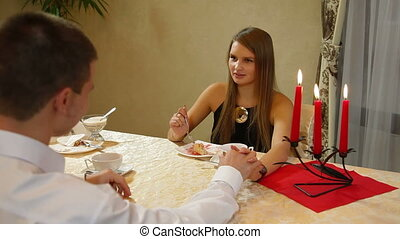 dining out - A young couple eating dessert at a restaurant