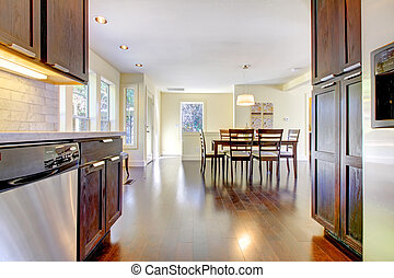 Dining room and kitchen in bright modern home.