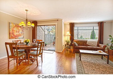 Dining room and living room - Dining area and living room in...