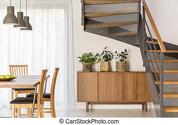 Dining room beside industrial staircase - Dining room...
